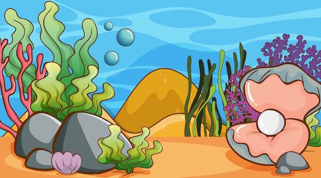 Scène met zeewier en parel onderwater