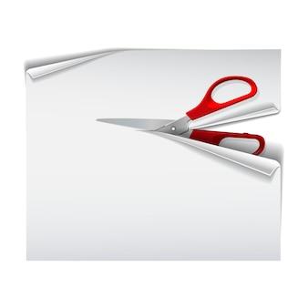 Schaar met rode plastic handvatten die witboekblad snijden