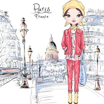Schattig brunette meisje in herfst kleding, hoofddoek en laarzen, jas en spijkerbroek in parijs, frankrijk