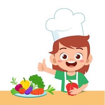Schattig gelukkig kind met groenten