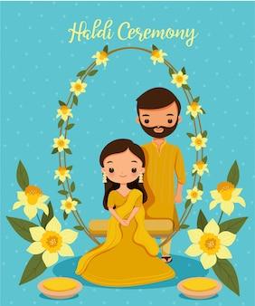 Schattig indiase paar in gele traditionele kleding voor haldi ceremonie op hun trouwdag