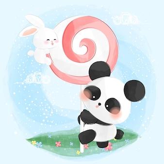 Schattig klein konijntje en panda eet lolly