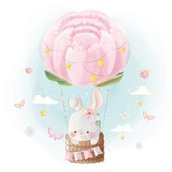Schattig klein konijntje vliegen met pioenrozen ballon
