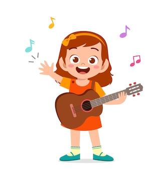 Schattig klein meisje gitaar spelen in overleg