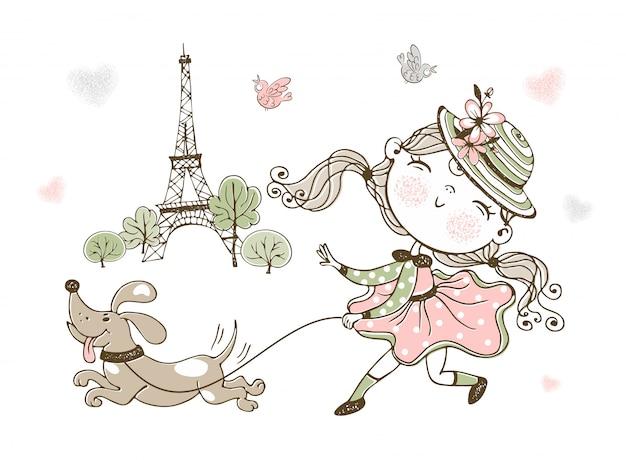 Schattig klein meisje haar hond wandelen in parijs.