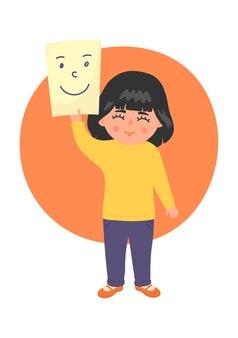 Schattig klein meisje houdt stuk papier teruggetrokken smileygezicht