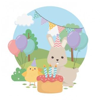 Schattig konijn en kuiken in verjaardagsfeestje