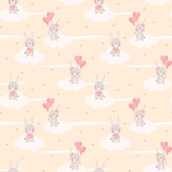 Schattig konijntje en hartvormige ballon naadloze patroon.