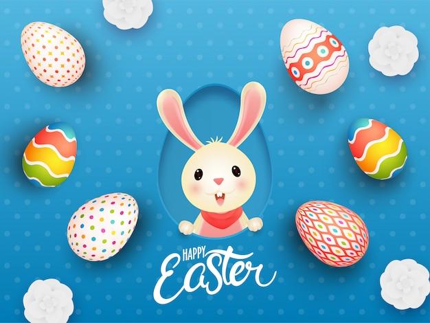 Schattig konijntje in papier gesneden eivorm met bovenaanzicht realistische gedrukte eieren en bloemen versierd op blauw