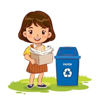 Schattig meisje met een container met papier naar de prullenbak