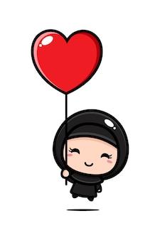 Schattig moslimmeisje dat met een ballon vliegt
