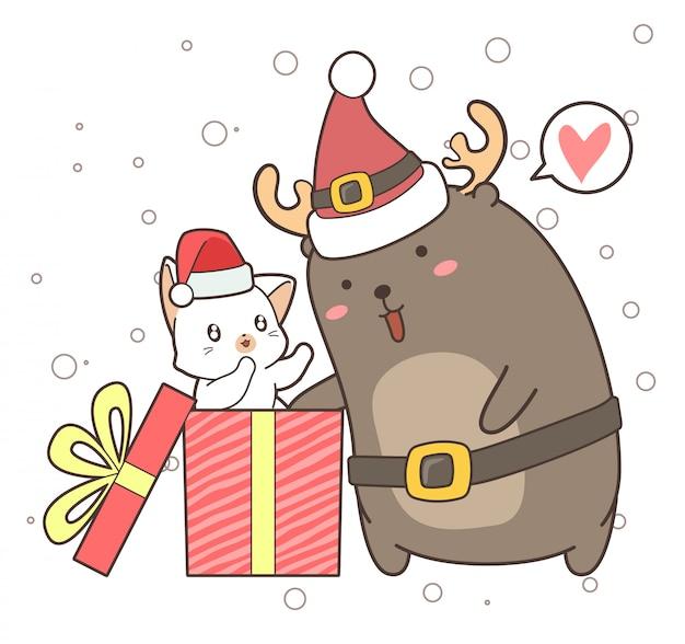 Schattig rendier en kat in de doos op eerste kerstdag