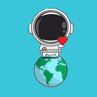 Schattige astronaut met liefde teken in aarde geïsoleerd op blauw