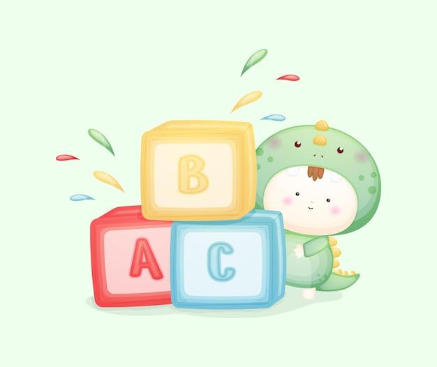 Schattige baby in dinosauruskostuum speelblokken premium vector