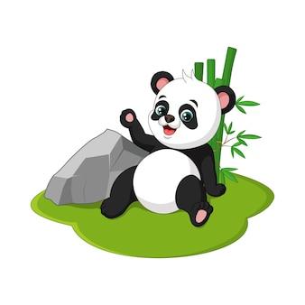 Schattige baby panda cartoon zittend in gras