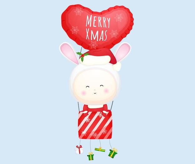 Schattige baby-santa die met luchtballon vliegt voor vrolijke kerstmisillustratie premium vector