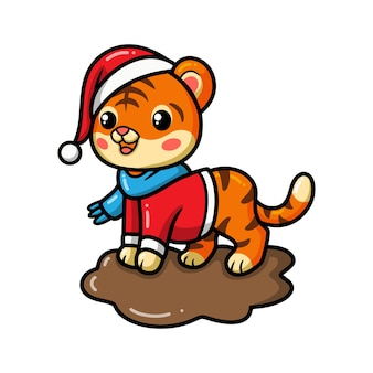 Schattige baby tijger cartoon met kerstmuts
