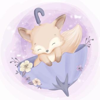 Schattige baby vos slaap op paraplu