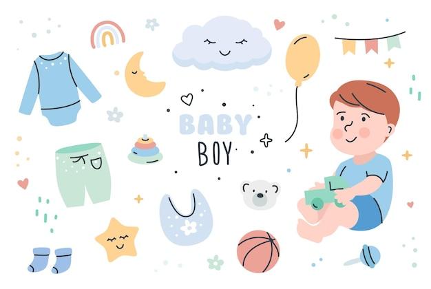 Schattige babyjongen met kleding en speelgoed set.