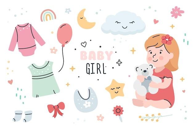Schattige babymeisje met kleding en speelgoed set.