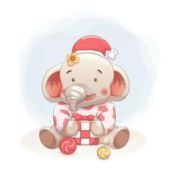 Schattige babyolifant blij om cadeau te krijgen in kerstmis.