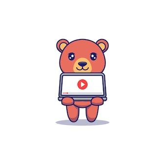 Schattige beer die video laat zien op laptop