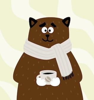 Schattige beer of kat met een kopje koffie of thee in een sjaal