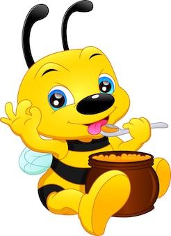 Schattige bij met honing geïsoleerd op een witte achtergrond