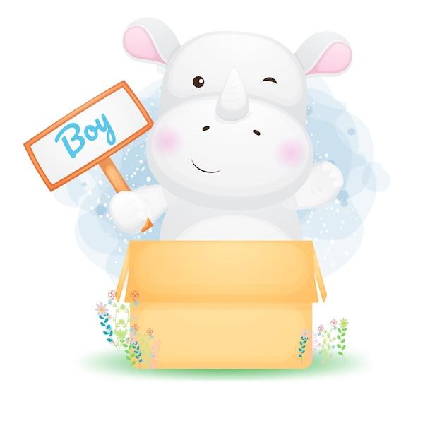 Schattige doodle baby neushoornjongen in de doos. babyshower