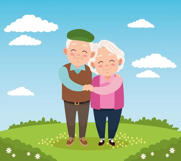 Schattige gelukkige grootouders paar in het kamp