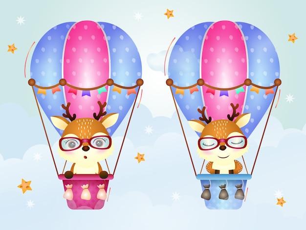 Schattige herten op hete luchtballon