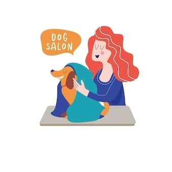 Schattige hond bij trimsalon vrouw maakt een kniphond hondenverzorgingsconcept