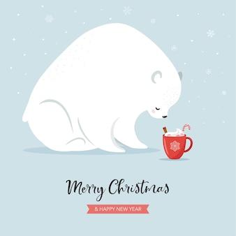 Schattige ijsbeer en warme chocolademelk mok, winter en kersttafereel.