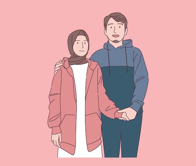 Schattige jonge moslimfamilie glimlachend hand getrokken illustratie gelukkige moslimman en -vrouw die hoodie dragen