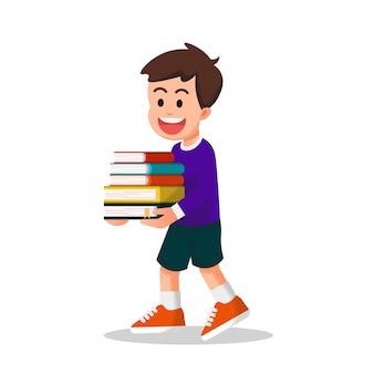 Schattige jongen met lange mouwen die wat boeken draagt