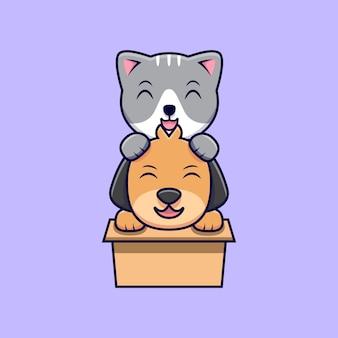 Schattige kat en hond spelen in kartonnen doos