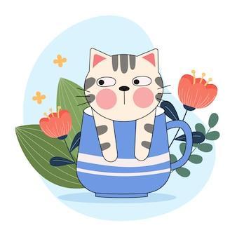 Schattige kat in een koffiekopje