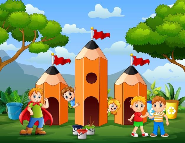 Schattige kinderen die spelen bij de illustratie van het potloodhuis