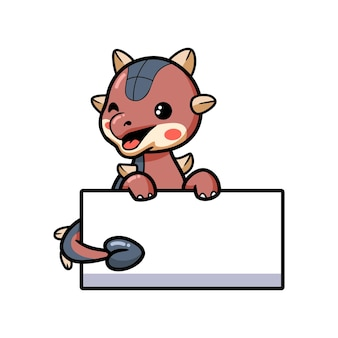 Schattige kleine ankylosaurus dinosaurus cartoon met leeg bord