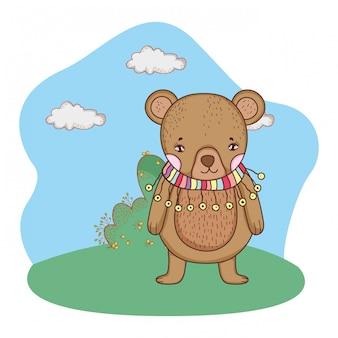 Schattige kleine beer met sjaal in het kamp