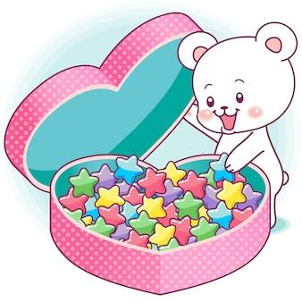 Schattige kleine beer opening van een gigantische hartvormige doos