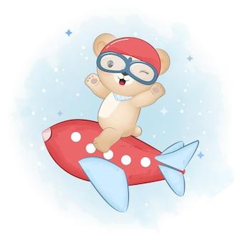 Schattige kleine beer zittend op het vliegtuig met de hand getekende illustratie