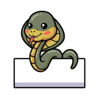 Schattige kleine cobra slang cartoon met leeg teken