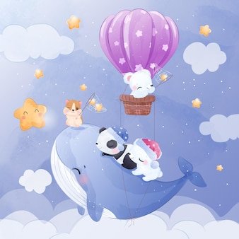 Schattige kleine dieren vliegen samen met een blauwe vinvis