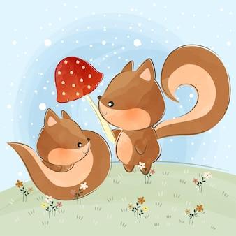 Schattige kleine eekhoorns en paddenstoelen