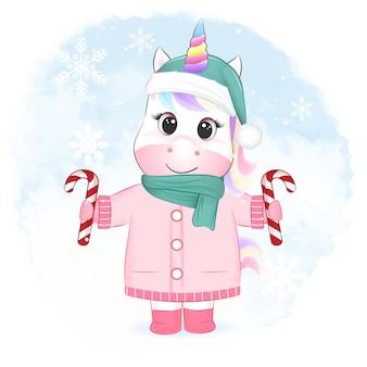 Schattige kleine eenhoorn met snoepgoed kerstseizoenillustratie