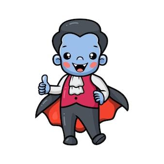Schattige kleine jongen dracula cartoon staat en geeft duim omhoog
