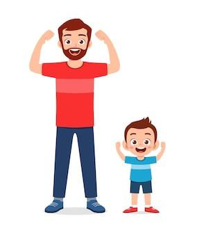 Schattige kleine jongen kopie vader sterke pose