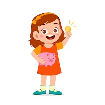 Schattige kleine jongen meisje draagt spaarvarken en gouden munt