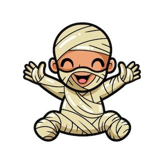 Schattige kleine jongen mummie cartoon handen opsteken